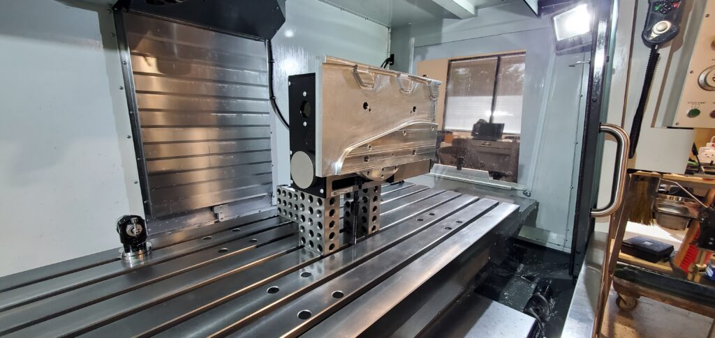 Metal part with pilot holes in a VF3SSYT with a HRT210 4th Axis machine.